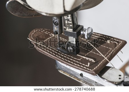 Sewing leather. Manual machine