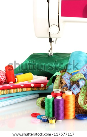 sewing machine and fabric isolated on white