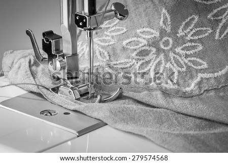 sewing machine and item of clothing. Old style - stock photo