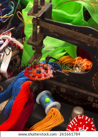 sewing machine and threads - stock photo