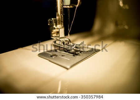 sewing machine at night with black background  - stock photo