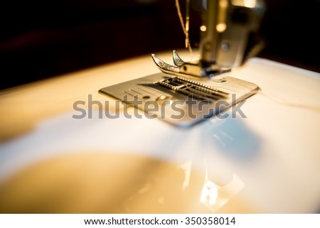 sewing machine at night with black background