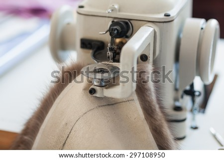Sewing machine for stitching of fur skins fur coat - stock photo