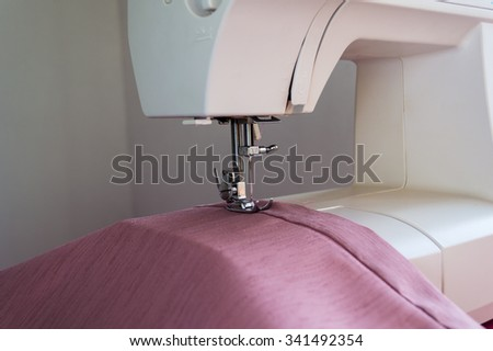 Sewing machine is ready for operation closeup - stock photo