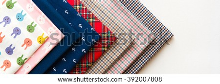 sewing machine. sew themselves. set of fabric for sewing. parts for sewing  interchangeable heads. sew. needle machines. thread. fabrics to suit every taste. sewing concept - stock photo