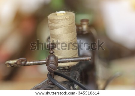 sewing machine with golden thread - stock photo