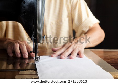 Sewing Process, Antique Sewing Machine with sewer, Focus at needle, Lowkey lighting