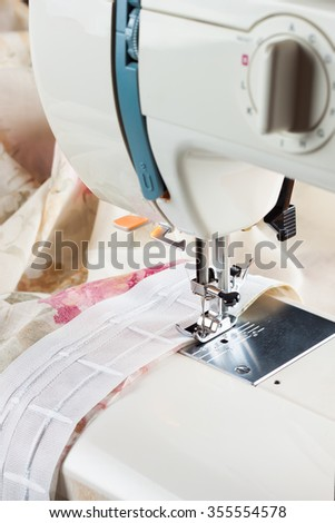 sewing process by a curtain tape on the sewing machine