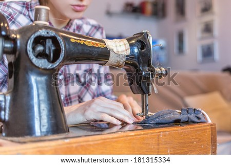 Sewing process on old sewing machine - stock photo