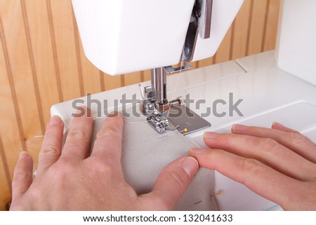 Sewing tan fabric on sewing machine