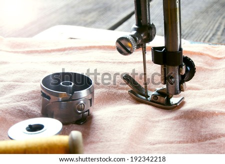 Sewing. The sewing machine and accessories. - stock photo