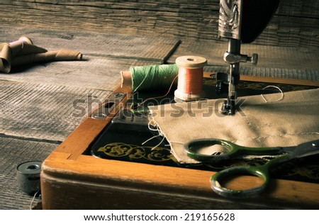 Sewing. The sewing machine and tools. - stock photo