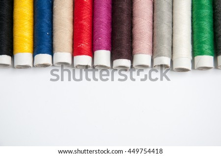 Sewing thread isolated on white background - stock photo
