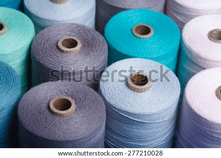 Sewing threads as a color background close up  - stock photo