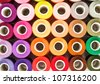 Sewing threads multicolored as a background close up - stock photo