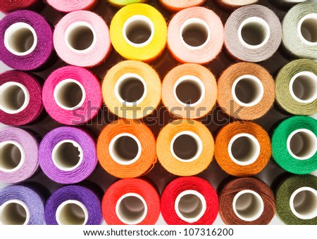 Sewing threads multicolored as a background close up