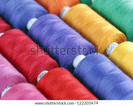 Sewing threads multicolored background - stock photo