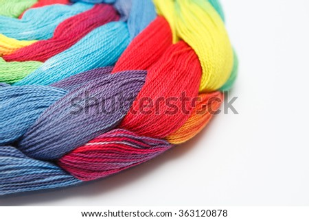 Sewing threads multicolored background closeup - stock photo