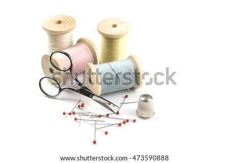 Sewing threads, scissors and pins