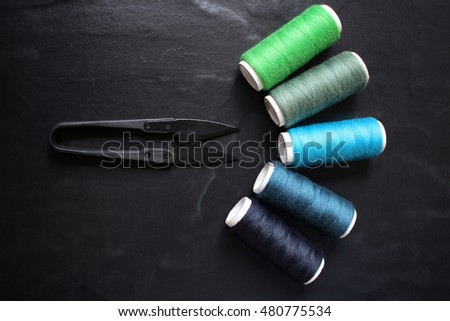 Sewing threads with scissors