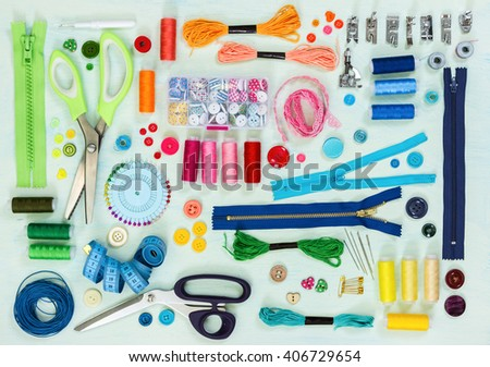Sewing tool and accessories on painted background blue color, top view. Flat lay. - stock photo