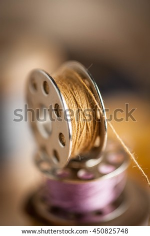 Sewing tools and sewing kit on wooden textured background