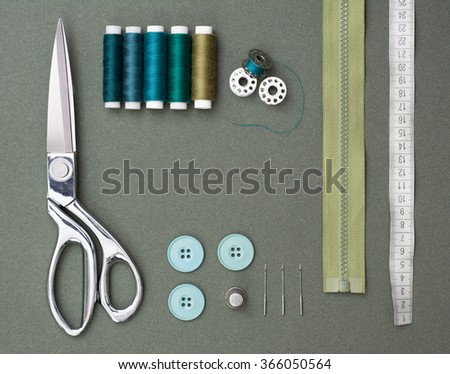 Sewing tools on green  background - stock photo