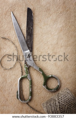 Sewing tools on paper background