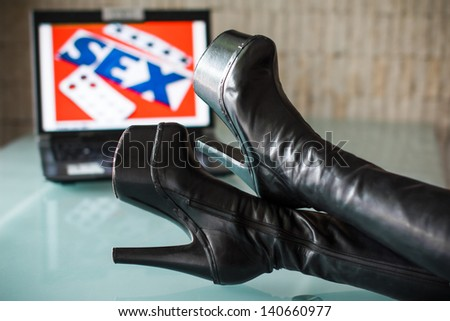 Sex, drug, rock and roll, black woman high heel boots