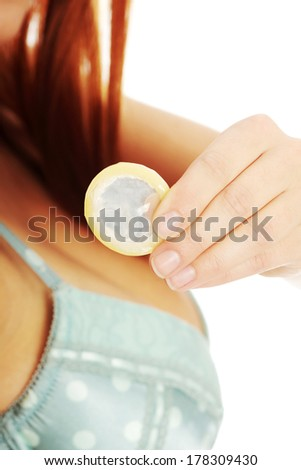 Sex education. Woman with condom (selective focus)  - stock photo