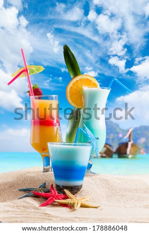 sex on the beach cocktail Long tailed boat in Koh Phi Phi island Thailand - stock photo