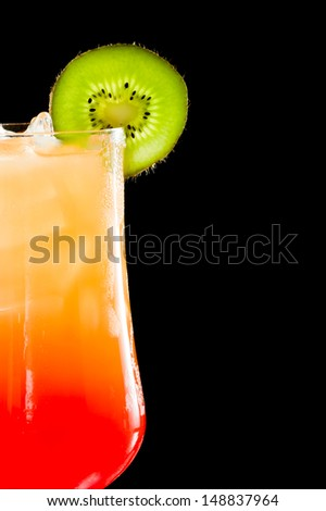 sex on the beach, fresh orange juice with vodka and cherry juice served in a stem glass on a dark bar - stock photo