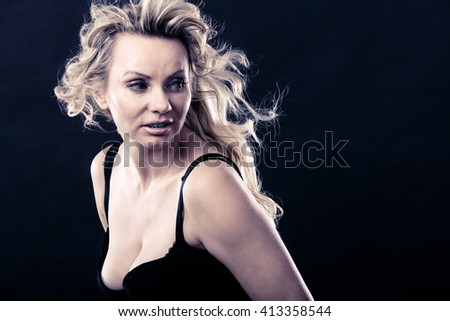 Sexiness of women. Attractive sensual blonde adult woman on dark background. Sexy beauty middle aged lady. - stock photo