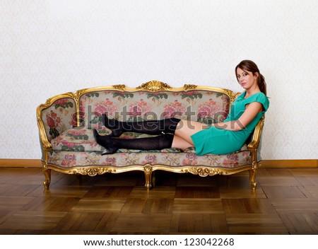 sexu italian woman couching in living room - stock photo