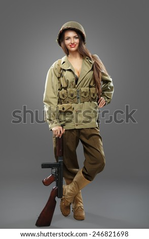Sexual Girl soldier posing with tommy gun. - stock photo