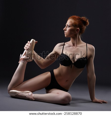 Sexual red-haired ballerina posing in lingerie - stock photo