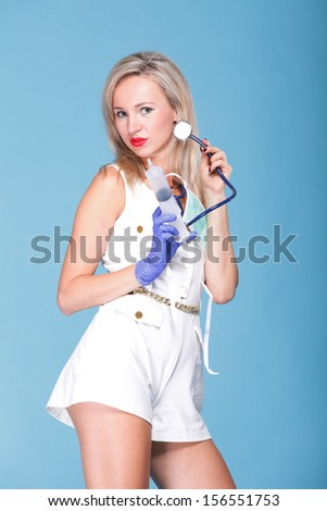 Sexual woman in nurse suit with stethoscope blue background
