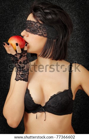 sexual woman in the linen with the red apple