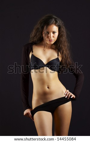sexual young girl in black underclothes - stock photo