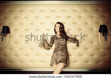Sexual young woman in a  luxurious classic interior. - stock photo