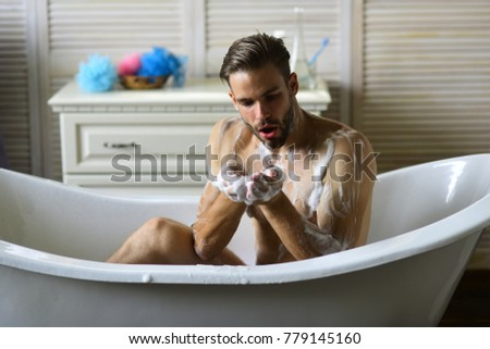 Macho Sitting Naked In Bathtub And Playing With Foam. Guy