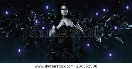 sexy adult woman in black dress with glass wings in dark - stock photo