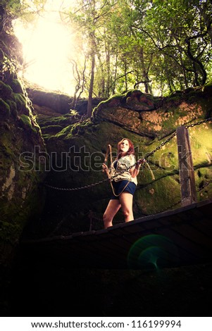 Sexy Adventurer on a Bridge - stock photo