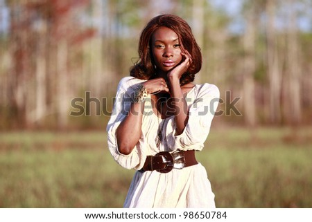 Sexy African American in the woods - stock photo