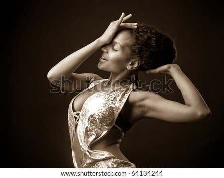 Sexy African go-go dancer in a moment of dance emotion - stock photo