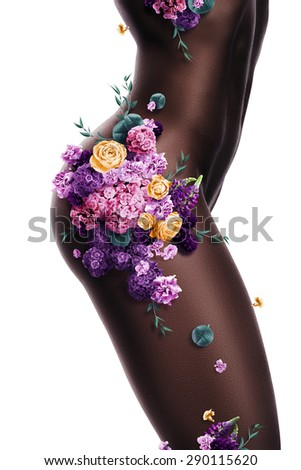 sexy afro woman with different flowers on body on white background - stock photo