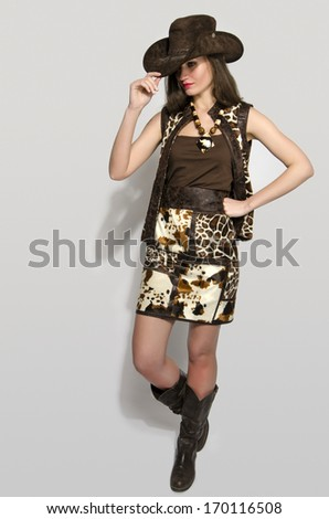 Sexy american cowgirl with jungle skirt,boots and a cowboy hat