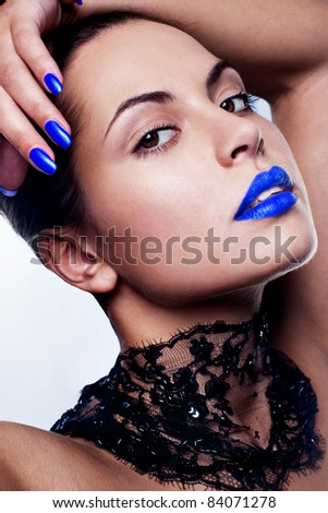 sexy and beautiful woman with blue make up - stock photo