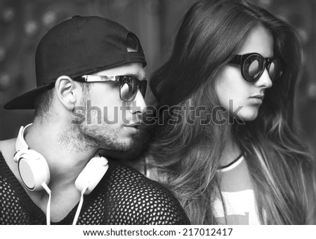 Sexy and fashionable couple in sunglasses. Vogue
