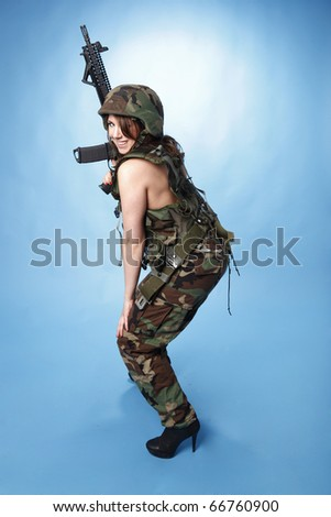 Sexy army woman with assault rifle.